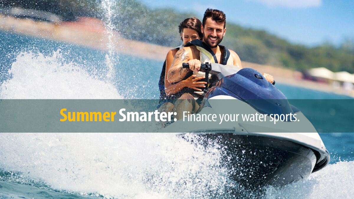 Couple enjoying riding a jet ski out on the open water.